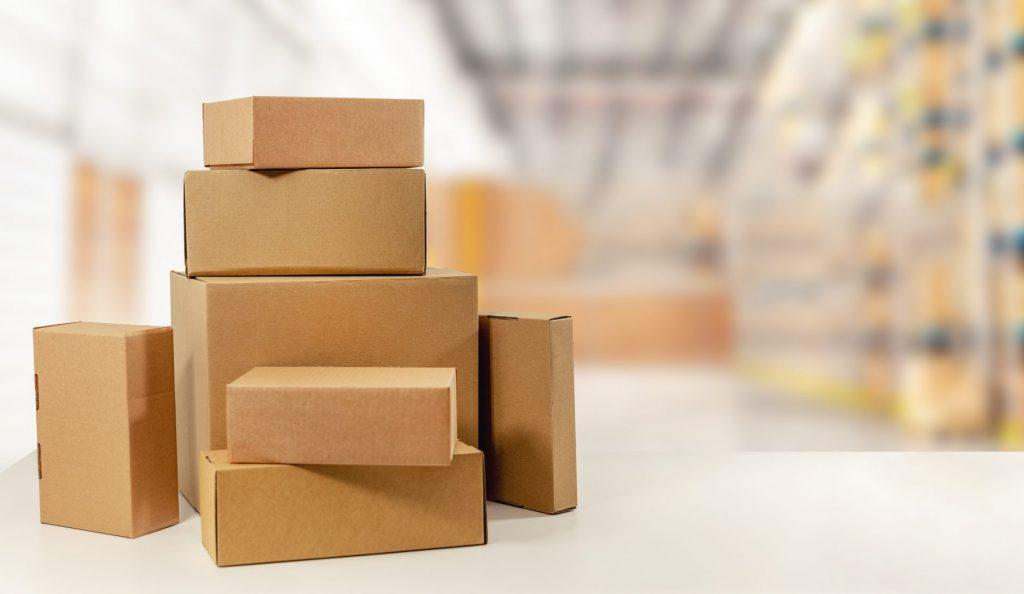 Brown cardboard parcels on a desk